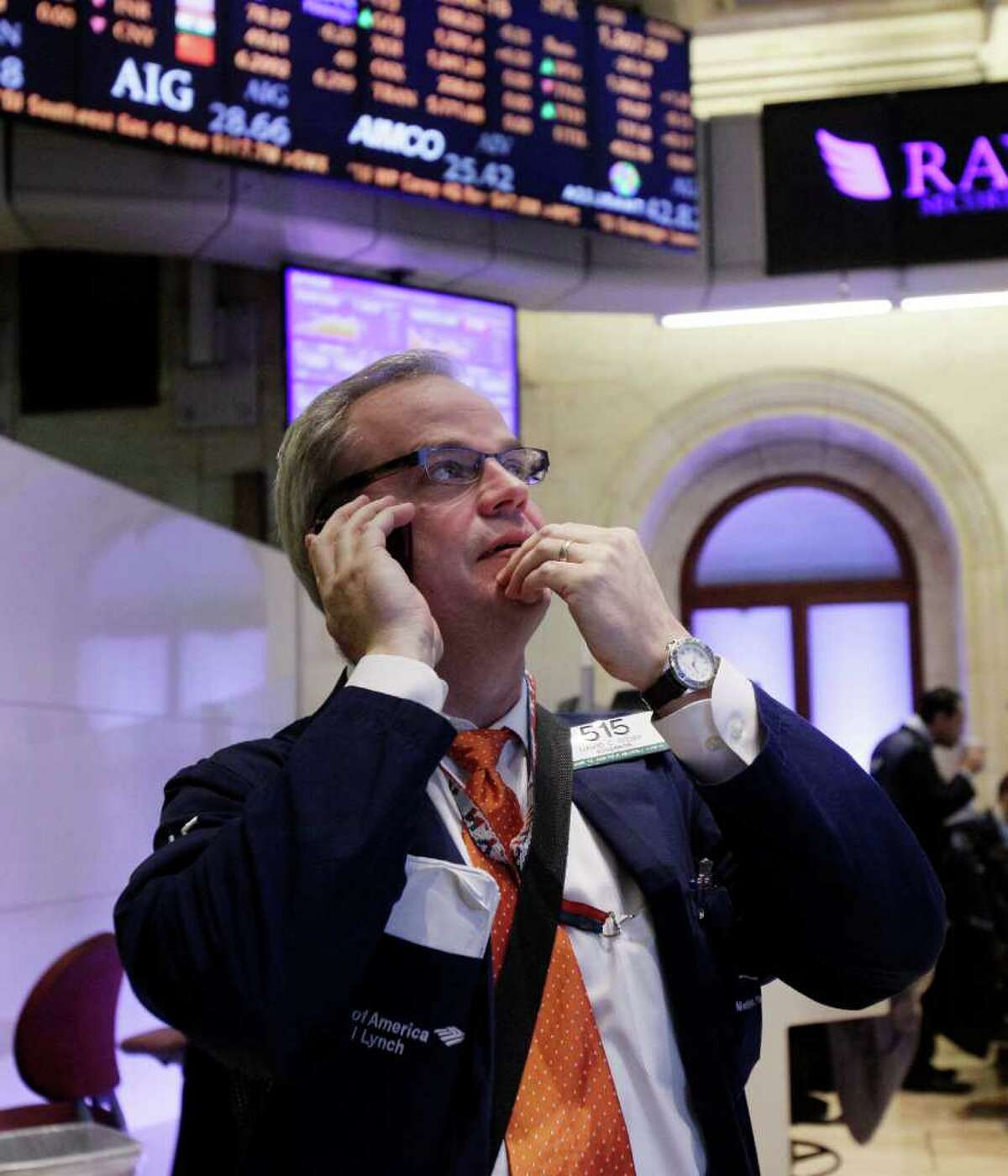 Trader David O'Day works on the floor of the New York Stock Exchange Tuesday, Feb. 28, 2012. Stocks are opening mixed after weak reports on factory orders and home prices. (AP Photo/Richard Drew)