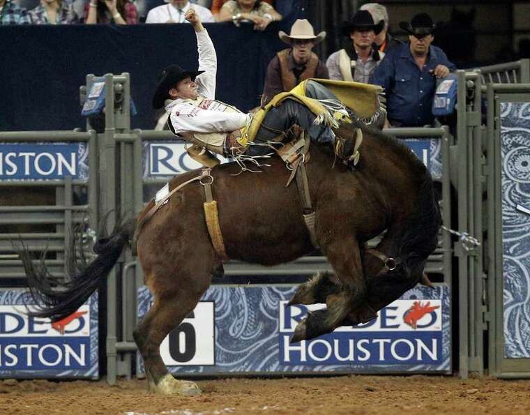 Bobby Mote competes during the Bareback Riding event at the Houston Livestock Shown and Rodeo Tuesda