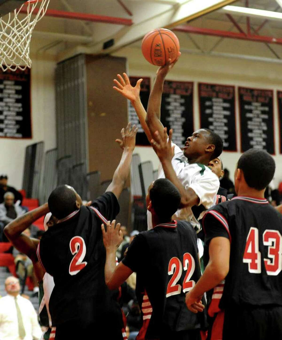 Bassick's #4 Kobe Ancurm looks to gain two points, during FCIAC Boys' Basketball Semi-final action against Central in Fairfield, Conn. on Tuesday February 28, 2012.