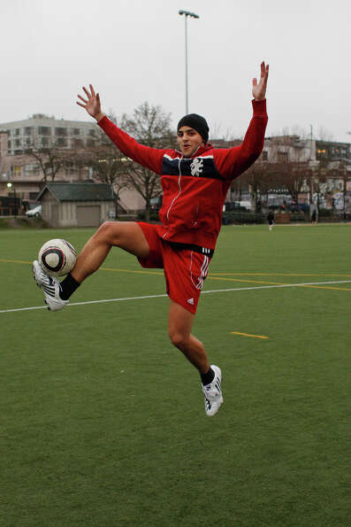 Marcus Warlick demonstrates a soccer leap in celebration of Leap Year day at Cal Anderson Park in Se