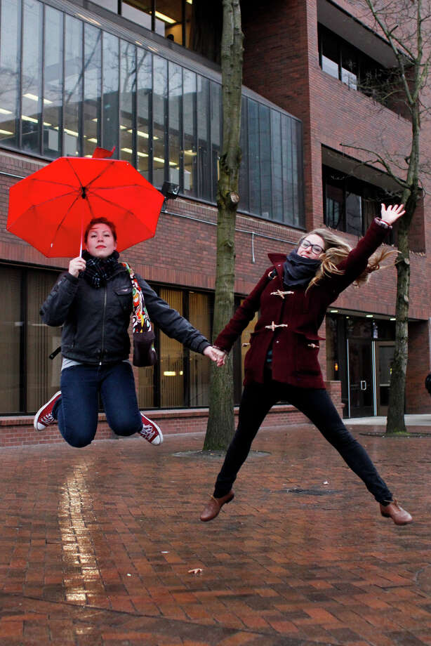 Callie Johnson and Danielle Stein leap in honor of Leap Year day at Seattle Central Community College on Tuesday, Feb. 28, 2012. Photo: JOE DYER / SEATTLEPI.COM