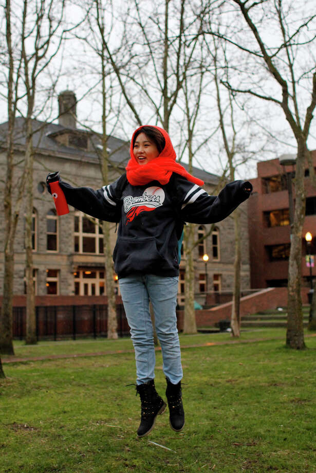 My Nguyen leaps in honor of the Leap Year day at Seattle Central Community College on Tuesday, Feb. 28, 2012. Photo: JOE DYER / SEATTLEPI.COM