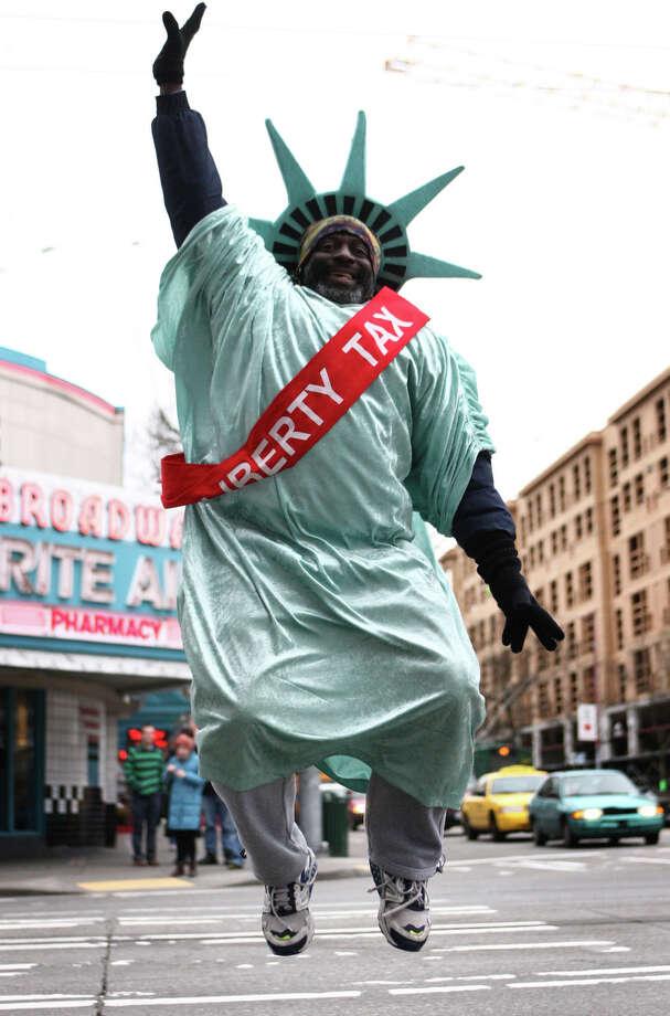 Frank Gray leaps in honor of Leap Year day on Tuesday, February 28, 2012. Photo: JOSHUA TRUJILLO / SEATTLEPI.COM