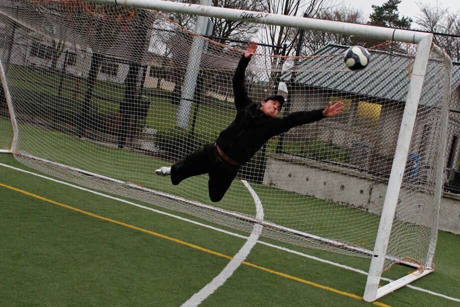 Antonio Cruz leaps during soccer at Cal Anderson Park in Seattle on Tuesday, Feb. 28, 2012. Photo: JOE DYER / SEATTLEPI.COM