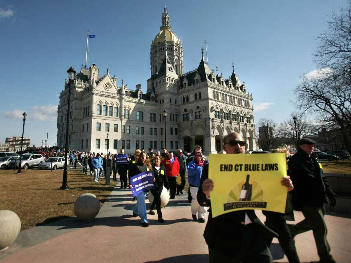 Supporters of Governor Malloy's liquor law reform bill march from a rally at the Capitol to a public hearing on the bill at the Legislative Office Building in Hartford on Tuesday, February 28, 2012.