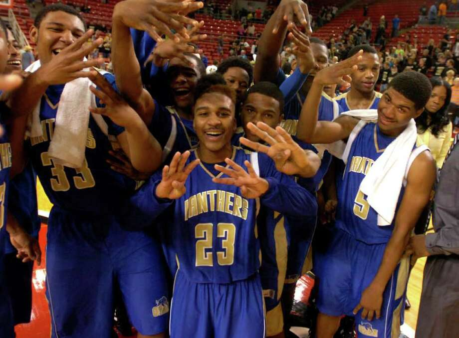 The Ozen Panthers celebrate their win over the Nederland Bulldogs at the Montagne Center at Lamar University in Beaumont, Tuesday, February 28, 2012. Tammy McKinley/The Enterprise Photo: TAMMY MCKINLEY