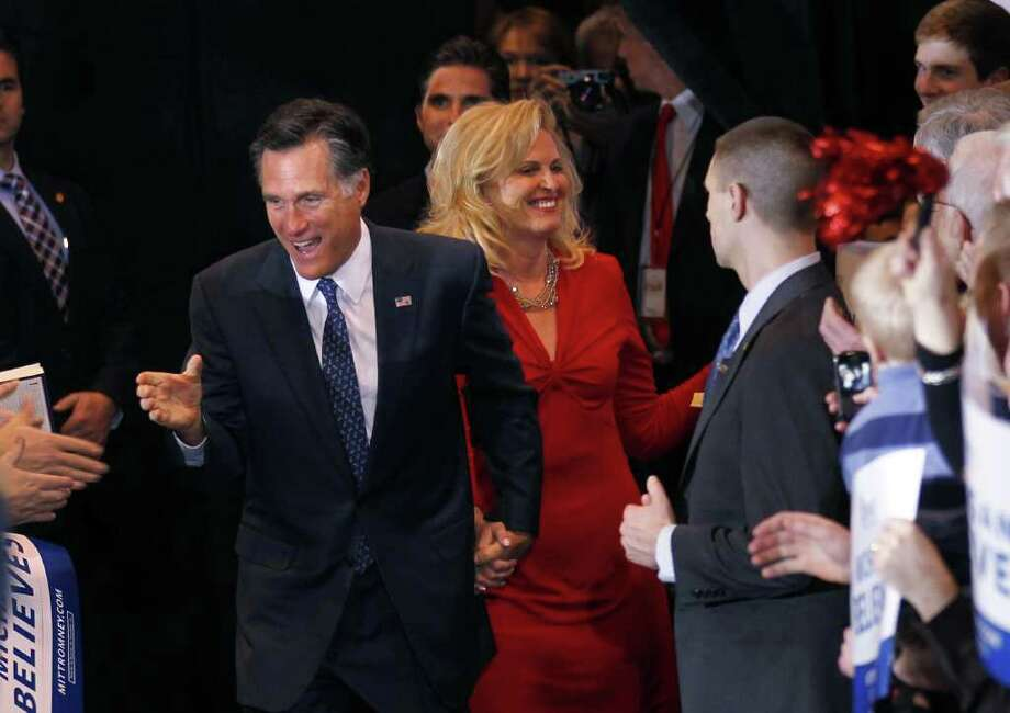 Republican presidential candidate, former Massachusetts Gov. Mitt Romney, arrives with his wife Ann at his election watch party after winning the Michigan primary in Novi, Mich., Tuesday, Feb. 28, 2012. Photo: Gerald Herbert, Associated Press / AP