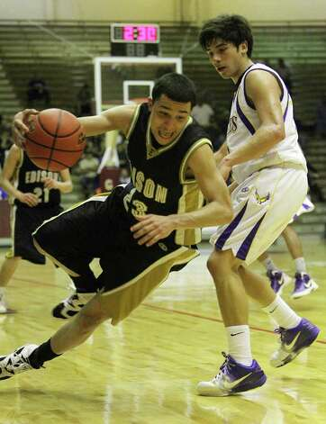 Edison's David Casias (23) slips as he drives around Brackenridge's Anthony Garza (12) in the third round of District 29-4A basketball at the Alamo Convocation Center on Tuesday, Feb. 28, 2012. Edison defeated Brackenridge, 64-53. Photo: Kin Man Hui, San Antonio Express-News / San Antonio Express-News