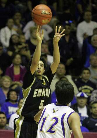 Edison's Arty Vela (05) hoists a three-pointer over Brackenridge's Anthony Garza (12) in the third round of District 29-4A basketball at the Alamo Convocation Center on Tuesday, Feb. 28, 2012. Edison defeated Brackenridge, 64-53. Photo: Kin Man Hui, San Antonio Express-News / San Antonio Express-News
