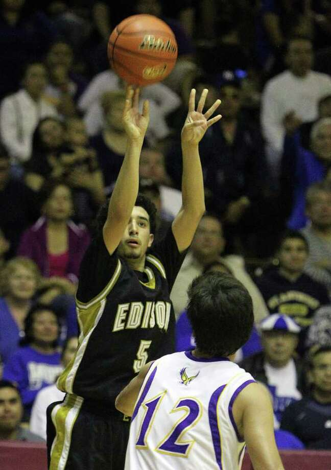 Edison's Arty Vela puts up a 3-pointer over Brackenridge's Anthony Garza during their Class 4A third-round playoff game. Photo: Kin Man Hui, San Antonio Express-News / San Antonio Express-News