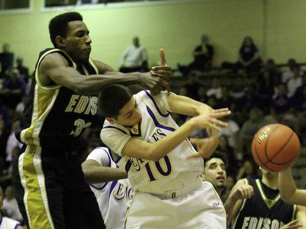 Edison's Phillip Johnson (33) and Brackenridge's Caleb Martinez (10) compete for a rebound in the third round of District 29-4A basketball at the Alamo Convocation Center on Tuesday, Feb. 28, 2012. Edison defeated Brackenridge, 64-53. Photo: Kin Man Hui, San Antonio Express-News / San Antonio Express-News