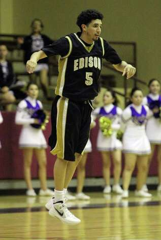 Edison's Arty Vela (05) leaps for joy after sinking a three-pointer against Brackenridge in the third round of District 29-4A basketball at the Alamo Convocation Center on Tuesday, Feb. 28, 2012. Edison defeated Brackenridge, 64-53. Photo: Kin Man Hui, San Antonio Express-News / San Antonio Express-News