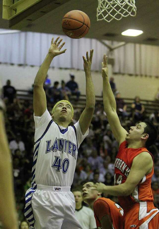 Lanier's Carlos Ibarra (40) gets off a shot against Burbank's Francisco Hernandez (44) in the third round of District 29-4A basketball at the Alamo Convocation Center on Tuesday, Feb. 28, 2012. Lanier defeated Burbank, 52-36. Photo: Kin Man Hui, San Antonio Express-News / San Antonio Express-News