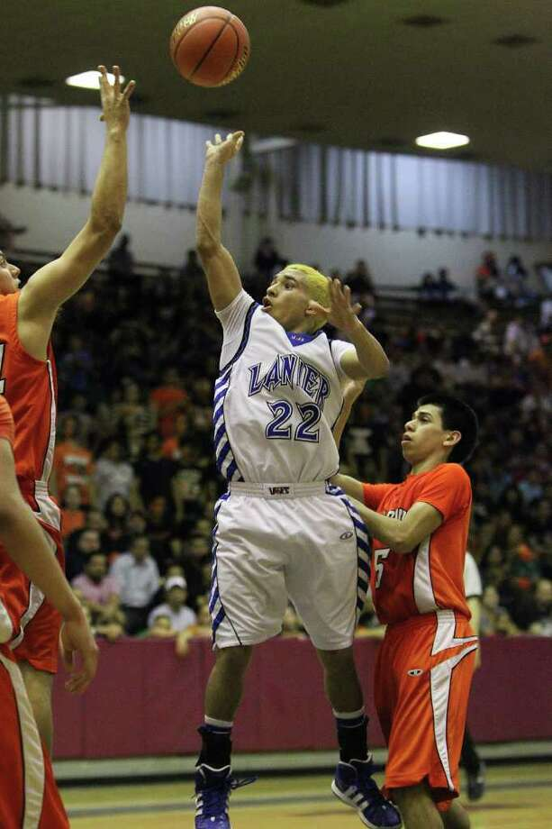 Lanier's Lou Garza (22) takes a shot against Burbank in the third round of District 29-4A basketball at the Alamo Convocation Center on Tuesday, Feb. 28, 2012. Lanier defeated Burbank, 52-36. Photo: Kin Man Hui, San Antonio Express-News / San Antonio Express-News