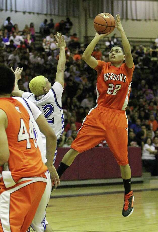 Burbank's Nathan Carrillo (22) takes an off-balance jumper against Lanier's Lou Garza in the third round of District 29-4A basketball at the Alamo Convocation Center on Tuesday, Feb. 28, 2012. Lanier defeated Burbank, 52-36. Photo: Kin Man Hui, San Antonio Express-News / San Antonio Express-News