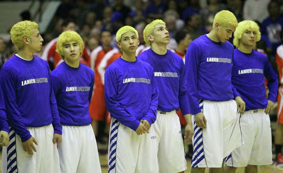 Lanier players sport blond-dyed hair for their game against Burbank in the third round of District 29-4A basketball at the Alamo Convocation Center on Tuesday, Feb. 28, 2012. Photo: Kin Man Hui, San Antonio Express-News / San Antonio Express-News