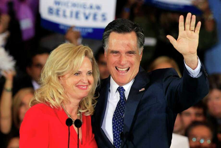 Republican presidential candidate, former Massachusetts Gov. Mitt Romney and his wife Ann Romney wave at his election night party in Novi, Mich., Tuesday, Feb. 28, 2012. (AP Photo/Carlos Osorio) Photo: Carlos Osorio