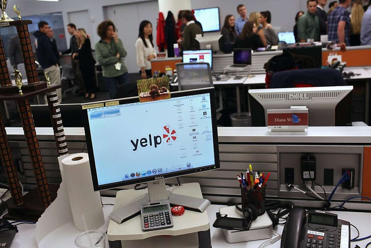 NEW YORK, NY - FILE: Employees of the online review site Yelp watch as New York City Mayor Michael Bloomberg speaks at the new East Coast headquarters of the tech company on October 26, 2011 in New York City. Yelp announced February 17, 2012 that the company has set a target price for its IPO at $12 to $14 each for 7.1 million shares. (Photo by Spencer Platt/Getty Images)