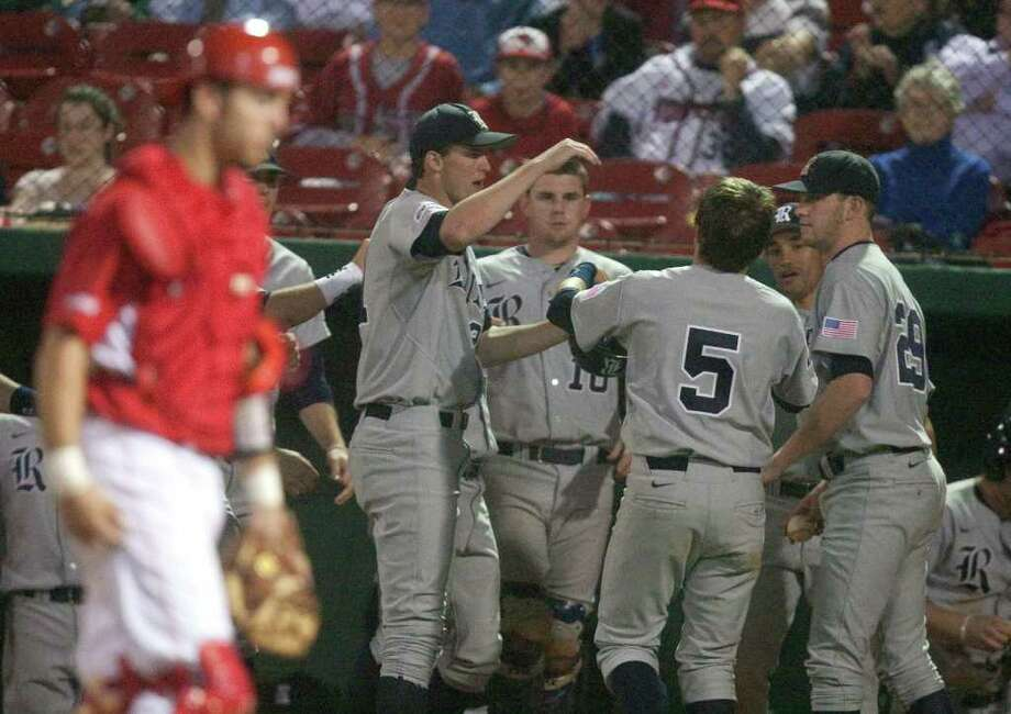 Rice's Michael Ratterree (5) receives a warm welcome after scoring in the sixth. Photo: J. Patric Schneider / Houston Chronicle