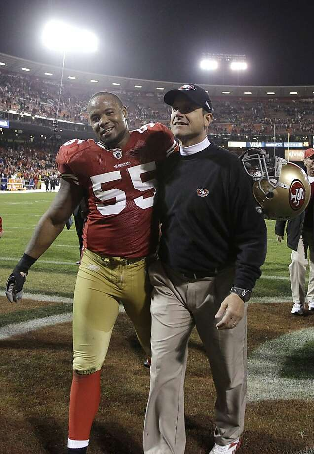 FILE - In this Dec. 19, 2011, file photo, San Francisco 49ers linebacker Ahmad Brooks (55) and coach Jim Harbaugh walk off the field after an NFL football game against the Pittsburgh Steelers in San Francisco. Brooks signed a six-year contract extension with the 49ers on Tuesday, Feb. 28, 2012, that will take him through the 2017 season and keep one of the NFLís best linebacker corps intact. (AP Photo/Paul Sakuma, file) Photo: Paul Sakuma, Associated Press