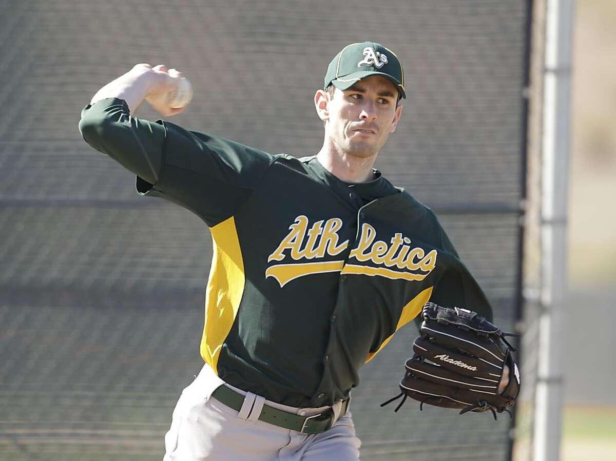 Oakland Athletics' Brandon McCarthy during a spring training baseball workout Tuesday, Feb. 21, 2012, in Phoenix. (AP Photo/Darron Cummings)