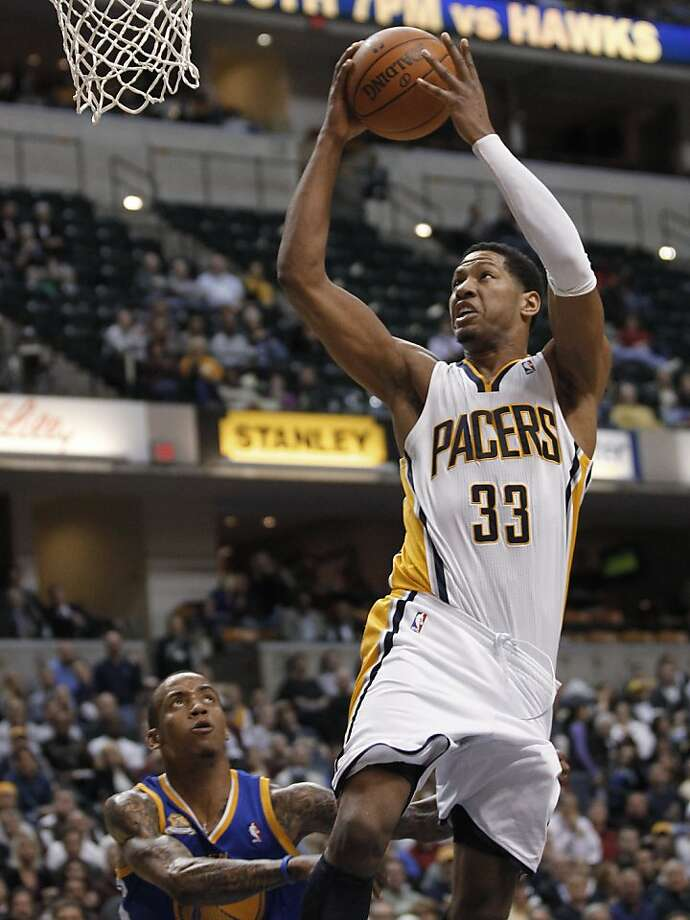 Indiana Pacers forward Danny Granger (33) goes to the basket over Golden State Warriors' Monta Ellis, left, during the third quarter of an NBA basketball game in Indianapolis on Tuesday, Feb. 28, 2012. Granger scored 25 points in the Pacers' 102-78 win. (AP Photo/Dave Martin) Photo: Dave Martin, Associated Press