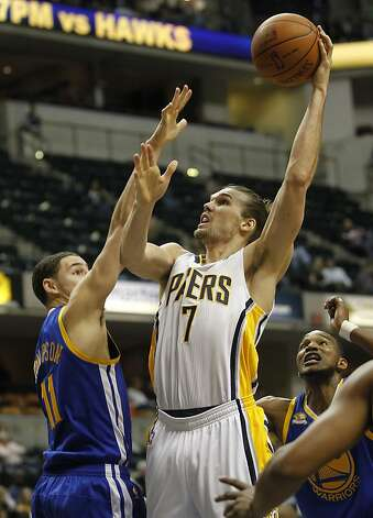 Indiana Pacers Lou Amundson goes to the basket over Golden State Warriors Klay Thompson (11) during the fourth quarter of their NBA basketball game in Indianapolis on Tuesday, Feb. 28, 2012. The Pacers beat the Warriors 102-78. (AP Photo/Dave Martin) Photo: Dave Martin, Associated Press