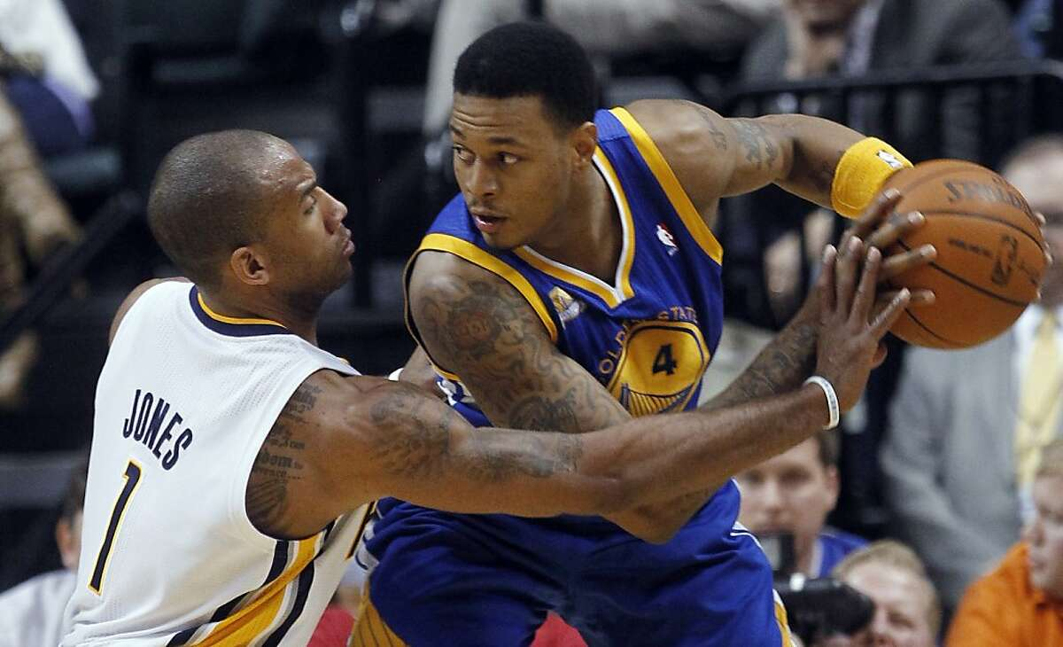 Indiana Pacers Dahntay Jones (1) guards Golden State Warriors' Brandon Rush (4) during the fourth quarter of an NBA basketball game in Indianapolis on Tuesday, Feb. 28, 2012. The Pacers beat the Warriors 102-78. (AP Photo/Dave Martin)