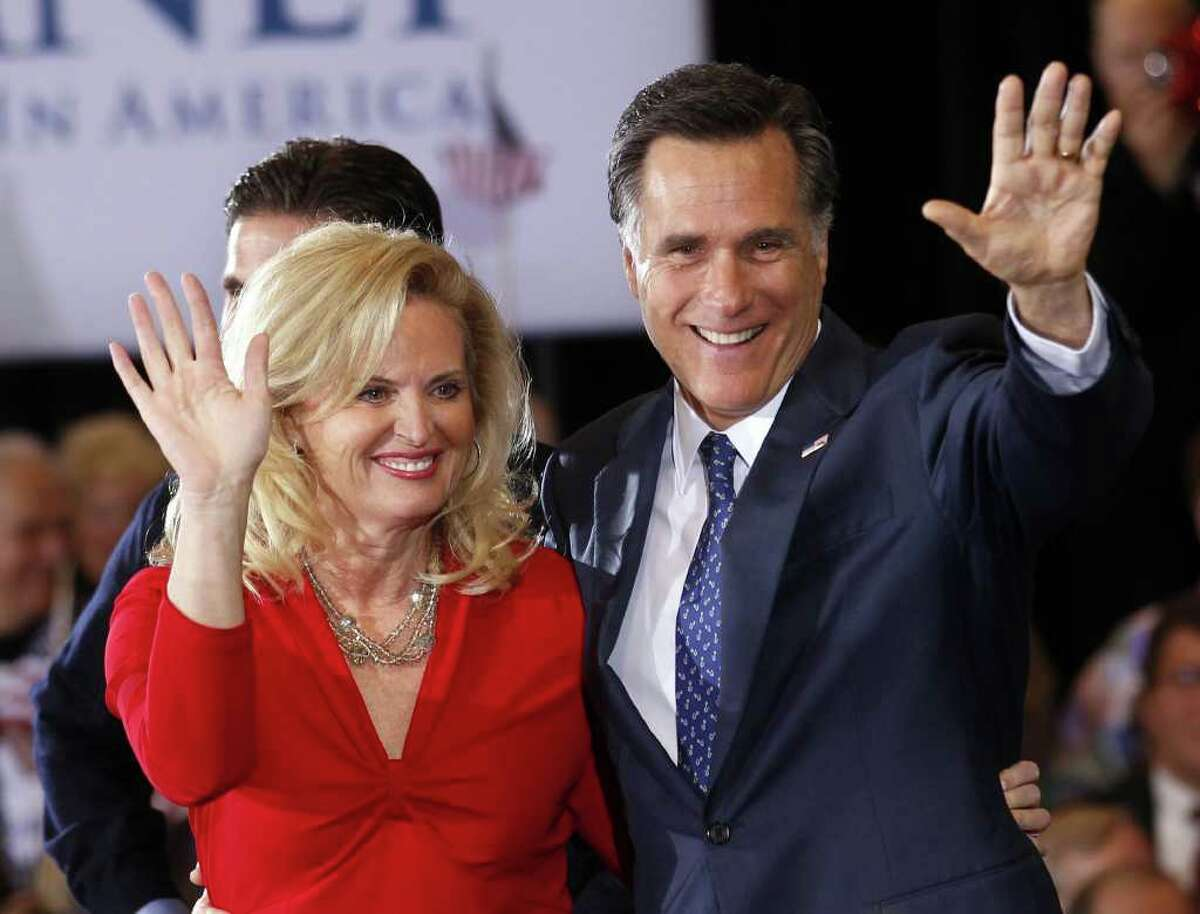 Republican presidential candidate, former Massachusetts Gov. Mitt Romney, waves to supporters with his wife Ann at his election watch party after winning the Michigan primary in Novi, Mich., Tuesday, Feb. 28, 2012. (AP Photo/Gerald Herbert)