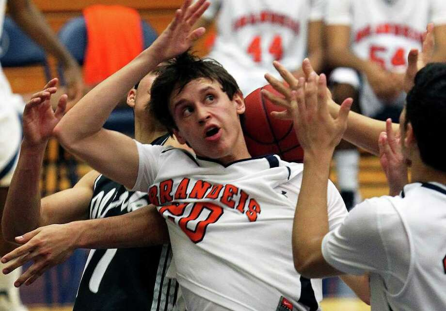 Brandeis guard Aaron Balderrama loses the ball over his shoulder as Clark beats the Broncos 45-39 at Taylor Field House on Tuesday, Feb. 28, 2012. Photo: TOM REEL, San Antonio Express-News / San Antonio Express-News