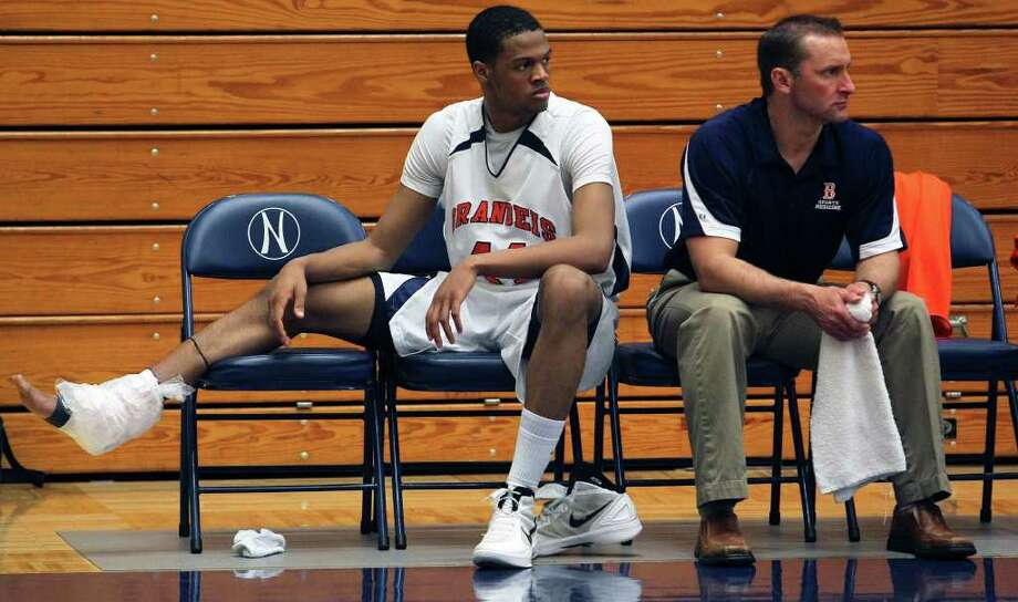 Brandeis post Eric Robinson sits out the second half with ice on his ankle as Clark beats the Broncos 45-39 at Taylor Field House on Tuesday, Feb. 28, 2012. Photo: TOM REEL, San Antonio Express-News / San Antonio Express-News