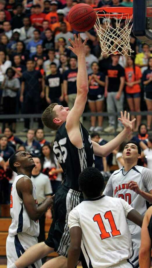 Clark post John Chapman gets a layup in a crowd as the Cougars beat Brandeis 45-39 at Taylor Field House on Tuesday, Feb. 28, 2012. Photo: TOM REEL, San Antonio Express-News / San Antonio Express-News