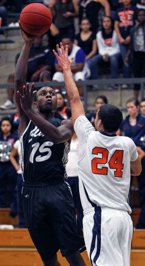 Clark forward Travis Matthews shoots over Brandeis' Jeremy Martinez as the Cougars beat the Broncos 45-39 at Taylor Field House on Tuesday, Feb. 28, 2012. Photo: TOM REEL, San Antonio Express-News / San Antonio Express-News