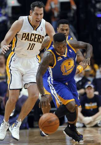 Golden State Warriors guard Nate Robinson (2) steals the ball from Indiana Pacers' Jeff Foster (10) during the first quarter of an NBA basketball game in Indianapolis on Tuesday, Feb. 28, 2012. Photo: Dave Martin, Associated Press