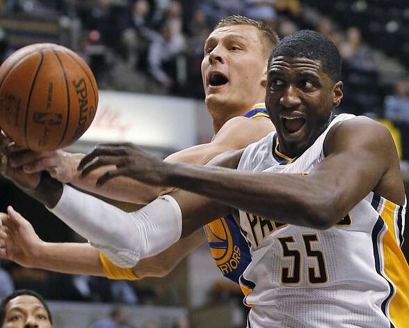 Indiana Pacers center Roy Hibbert (55) vies for a rebound with Golden State Warriors center Andris Biedrins during the first quarter of an NBA basketball game in Indianapolis on Tuesday, Feb. 28, 2012. Photo: Dave Martin, Associated Press