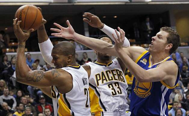 Golden State Warriors forward David Lee, right, competes for a rebound with Indiana Pacers forwards David West (21) and Danny Granger (33) for a rebound during the first quarter of an NBA basketball game in Indianapolis on Tuesday, Feb. 28, 2012. Photo: Dave Martin, Associated Press