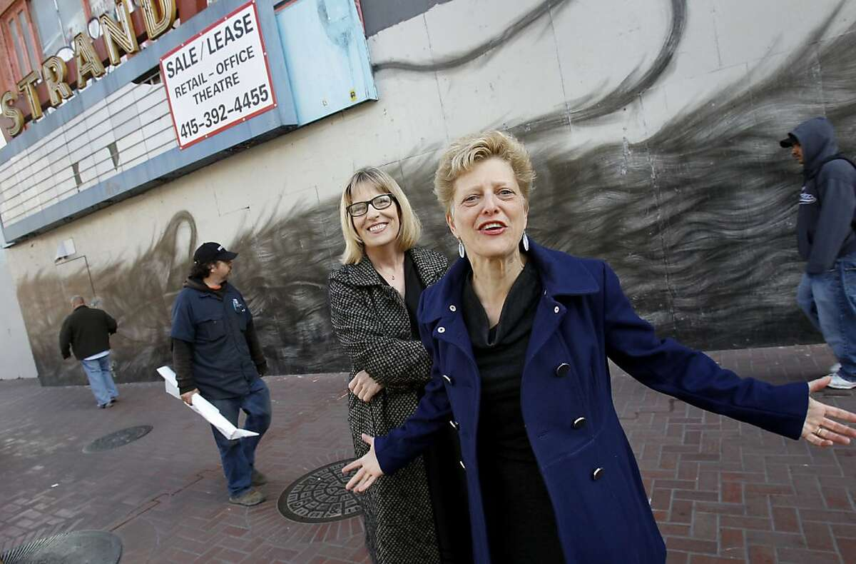 ACT's artistic director Carey Perloff (right) and executive director Ellen Richard get animated in front of their new theater. The American Conservatory Theater has purchased the old Strand Theater, a historic cinema house in the mid-Market area of San Francisco, Calif.