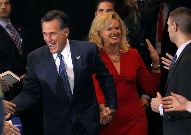 Republican presidential candidate, former Massachusetts Gov. Mitt Romney, arrives with his wife Ann at his election watch party after winning the Michigan primary in Novi, Mich., Tuesday, Feb. 28, 2012. Photo: Gerald Herbert, Associated Press