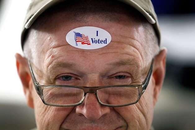 "John Vandermark wears his "" I Voted"" sticker after voting on primary day  as Michigan heads to the polls at Royal Oak Farmers Market on February 28, 2012 in Royal Oak, Michigan. Voters head to the polls as the Republican party continues the process of deciding who will be their general election candidate against President Barack Obama. Photo: Joe Raedle, Getty Images"