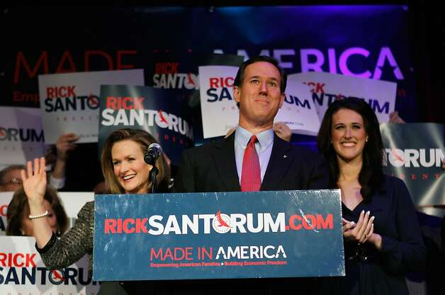 Rick Santorum addresses supporters as his wife Karen (L) and daughter Elizabeth Santorum (R) look on at a primary night gathering on February 28, 2012 in Grand Rapids, Michigan.  ArizonVoters in Michigan and Arizona went to the polls today to pick their choice for the Republican presidential nominee. Romney won both contests. Photo: Joe Raedle, Getty Images