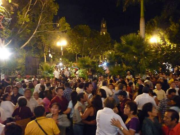 Around 7 p.m. on Saturdays at Merida en Domingo, in front of the Municipal Palace, a large band plays mambos, rumbas, and cha-chas, spurring as many as 1,000 people to dance in the street. Photo: Christine Delsol, Special To SFGate