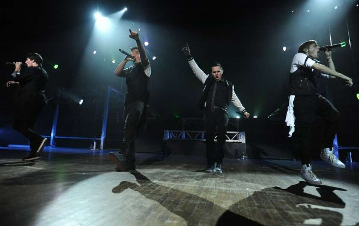 From left, James Maslow, Logan Henderson, Carlos Pena, Jr. and Kendall Schmidt of Big Time Rush perform to a sold out audience at the Palace Theatre Tuesday, Feb. 28, 2012 in Albany, N.Y. (Lori Van Buren / Times Union) (Albany Times Union)