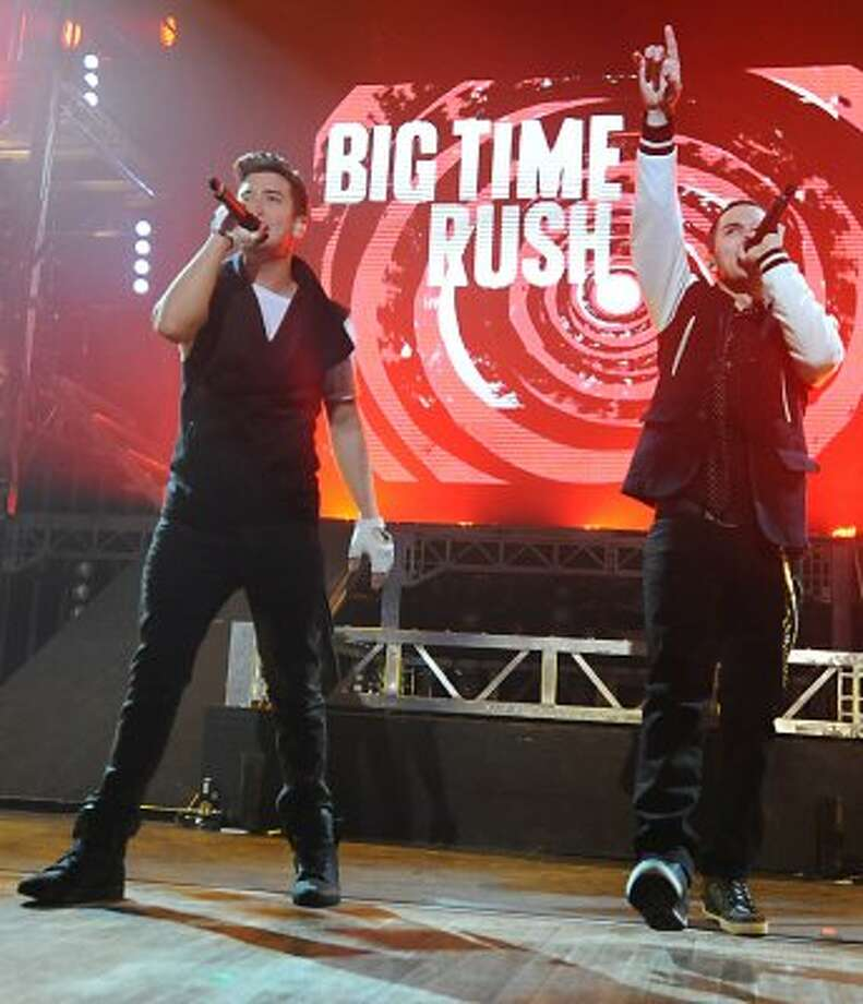 From left, Logan Henderson and Carlos Pena, Jr. of Big Time Rush perform to a sold out audience at the Palace Theatre Tuesday, Feb. 28, 2012 in Albany, N.Y.  (Lori Van Buren / Times Union) (Albany Times Union)
