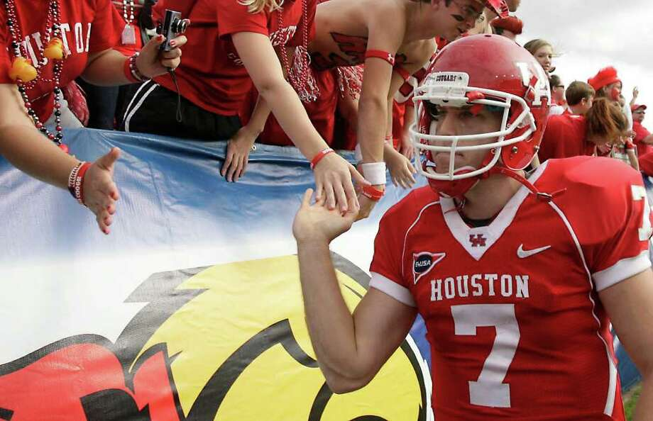 University of Houston quarterback Case Keenum (7) bites his lip as he visits the student section after the Cougars lost the 2011 Conference USA Football Championship game, Saturday, Dec. 3, 2011, in Robertson Stadium in Houston. The University of Southern Mississippi won 49-28. Photo: Nick De La Torre, Houston Chronicle / © 2011  Houston Chronicle