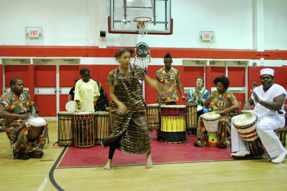 Musicians take the floor during the New Canaan YMCA's International Festival last year. This year's event takes place Sunday, March 4, from 1 to 4 p.m. Photo: Contributed Photo