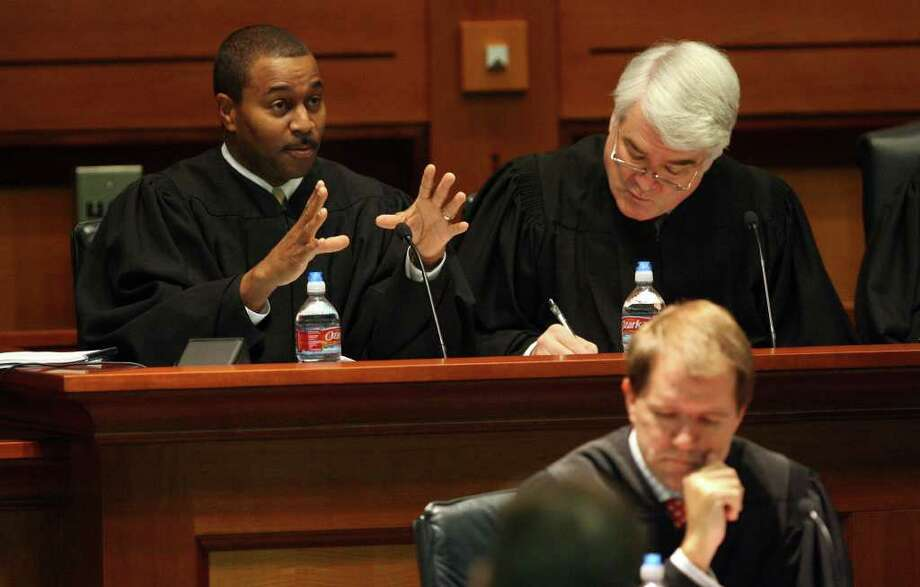 Property rights advocates are encouraged by the ruling, written by Justice Nathan L. Hecht (right). Photo: File Photo, San Antonio Express-News / jdavenport@express-news.net