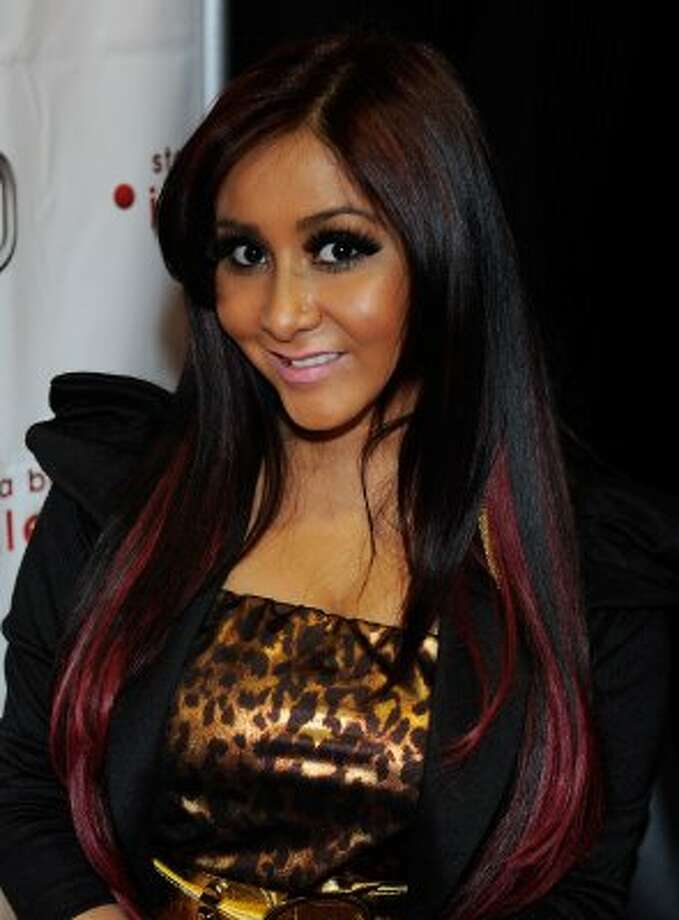 "Snooki saysher new son is handsome "" just like his father."""