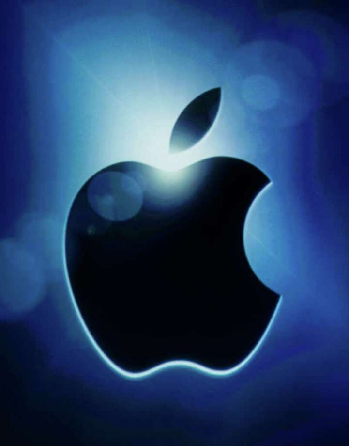 FILE - This Oct. 4, 2011 file photo, shows the Apple logo during an announcement at Apple headquarters in Cupertino, Calif. Apple's market capitalization topped $500 billion in opening trading Wednesday, Feb. 29, 2012, climbing to a mountain peak where few companies have ventured and none have stayed for long. (AP Photo/Paul Sakuma, File) Photo: Paul Sakuma / AP2011