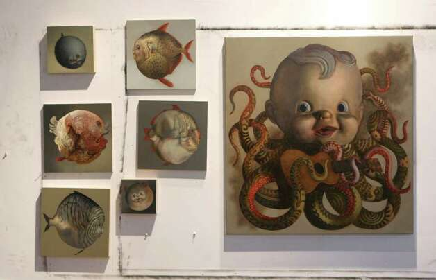 Bizarre creatures, some with baby doll heads, inhabit the art of Lloyd Walsh. Photo: Helen L. Montoya, San Antonio Express-News / ©SAN ANTONIO EXPRESS-NEWS