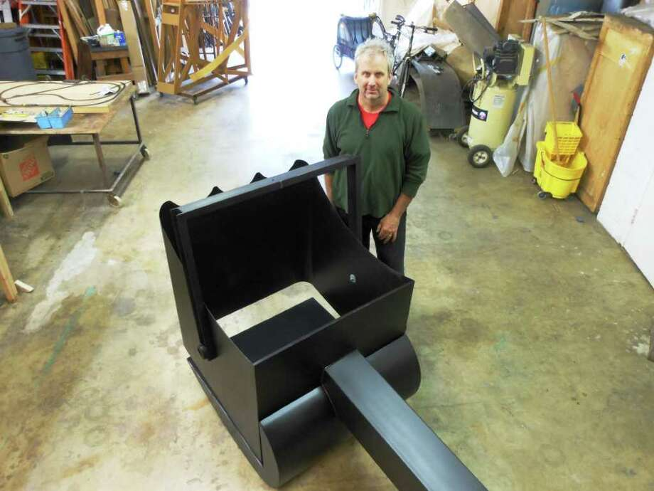 """San Antonio artist Riley Robinson's nostalgia for """"Mike Mulligan and His Steam Shovel"""" led to his latest steel sculptural work, a facsimile of an old dipper bucket.  Photo: Steve Bennett, San Antonio Express-News"""